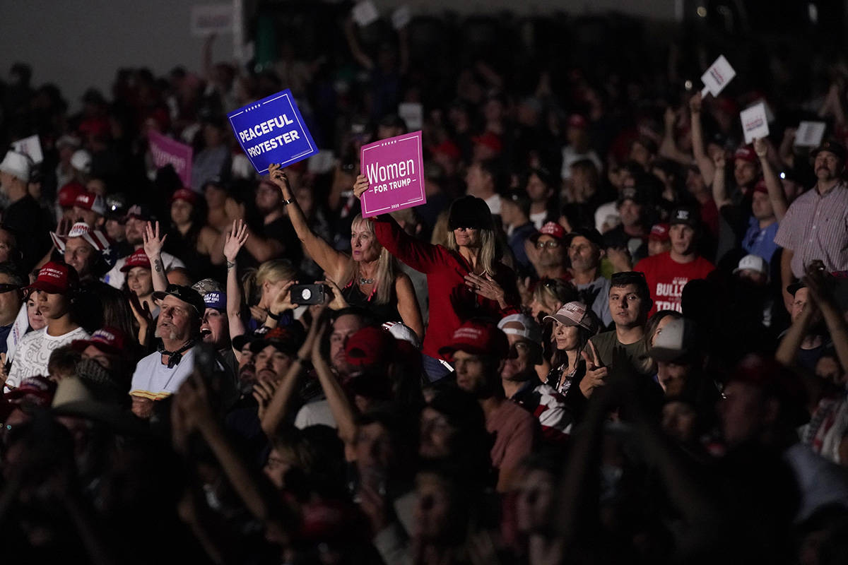 Supporters listen as President Donald Trump speaks at a rally at Minden-Tahoe Airport in Minden ...