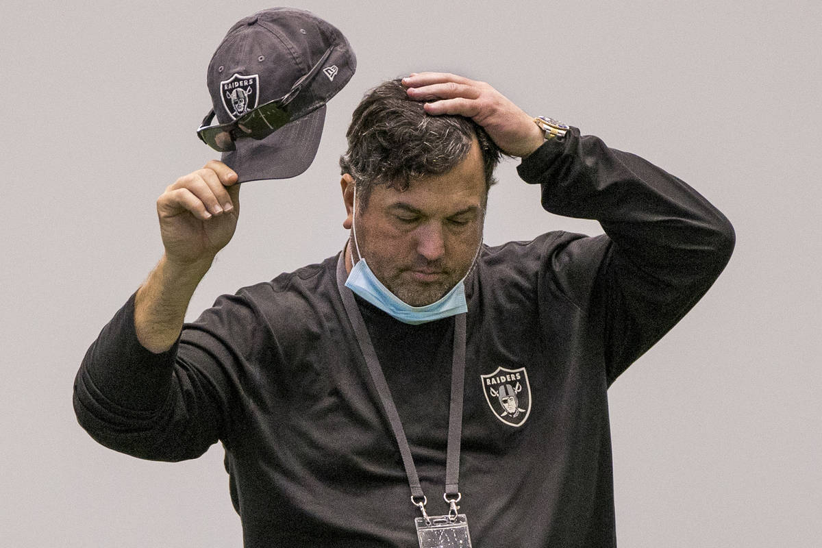 Las Vegas Raiders defensive coordinator Paul Guenther takes a moment to consider things during ...