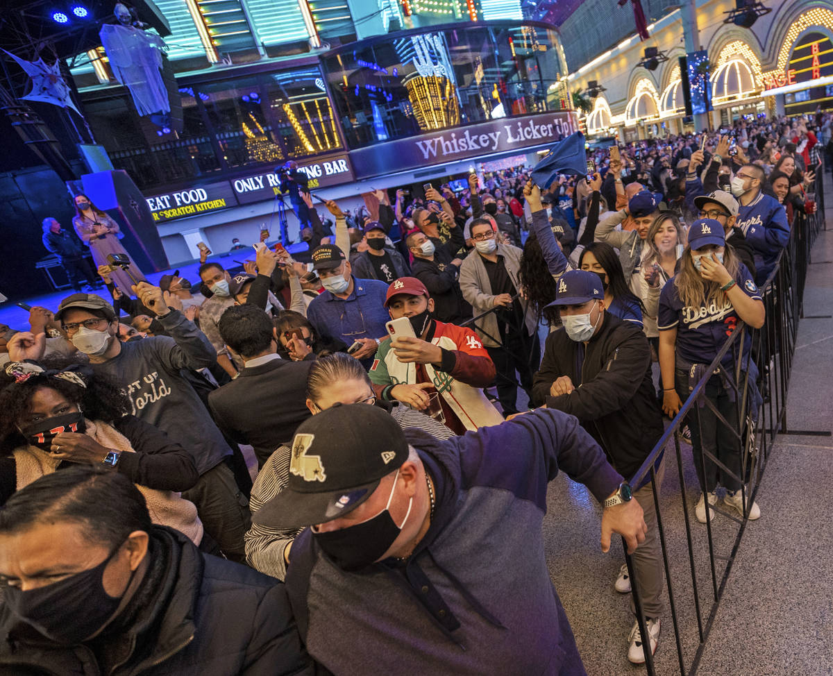 People rush into Circa for the first time during the resort's official opening night on ...