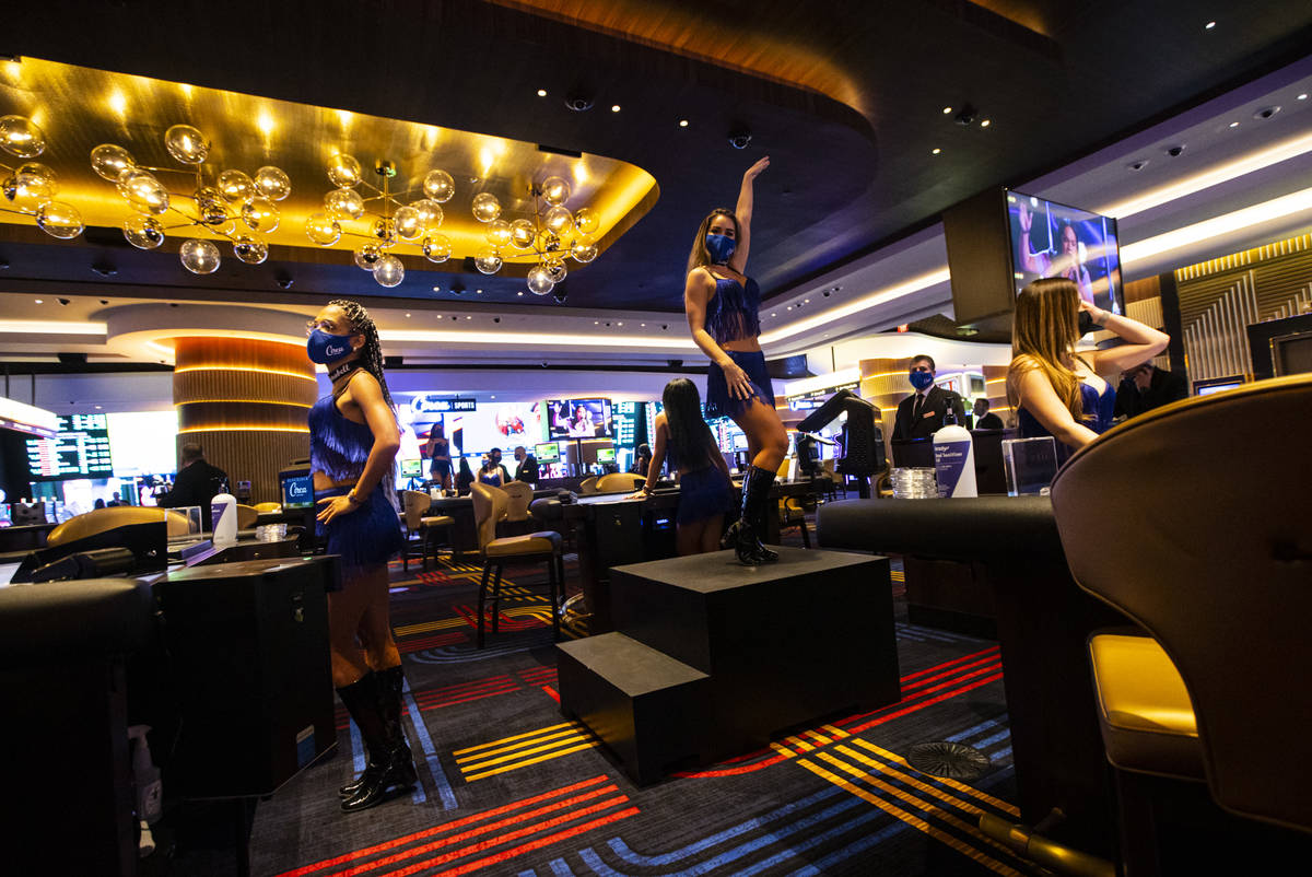 A dancer performs by table games at Circa during the VIP black-tie grand opening event in downt ...