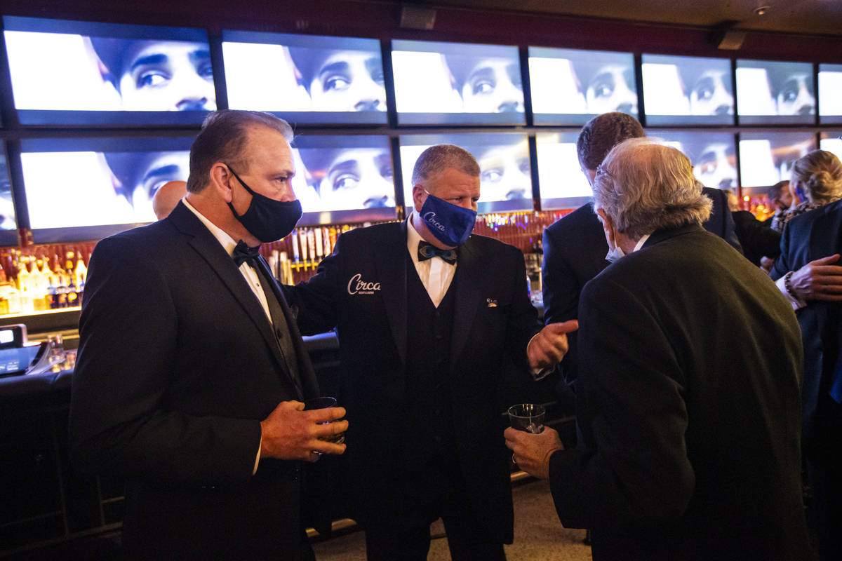 Circa owner Derek Stevens, center, mingles with friends and guests during the VIP black-tie gra ...