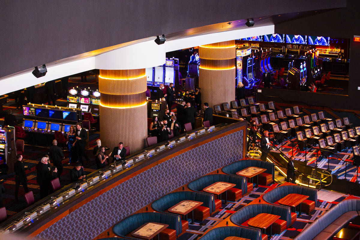 Invited guests explore Circa Sportsbook during the VIP black-tie grand opening event in downtow ...