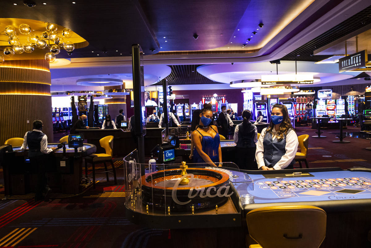 Table games dealers pose for photos during the VIP black-tie grand opening event at Circa in do ...