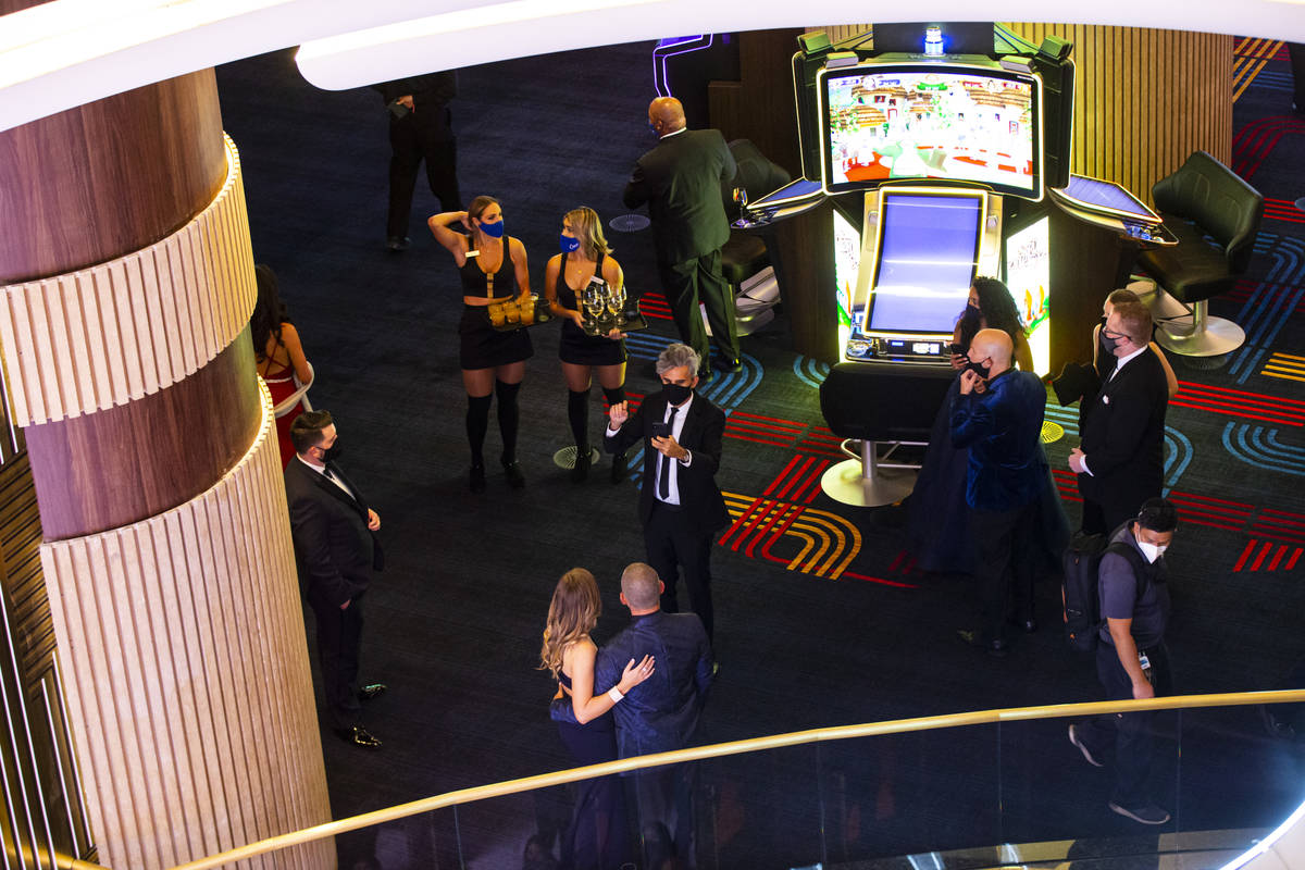 Invited guests pose for photos near Vegas Vickie during the VIP black-tie grand opening event a ...