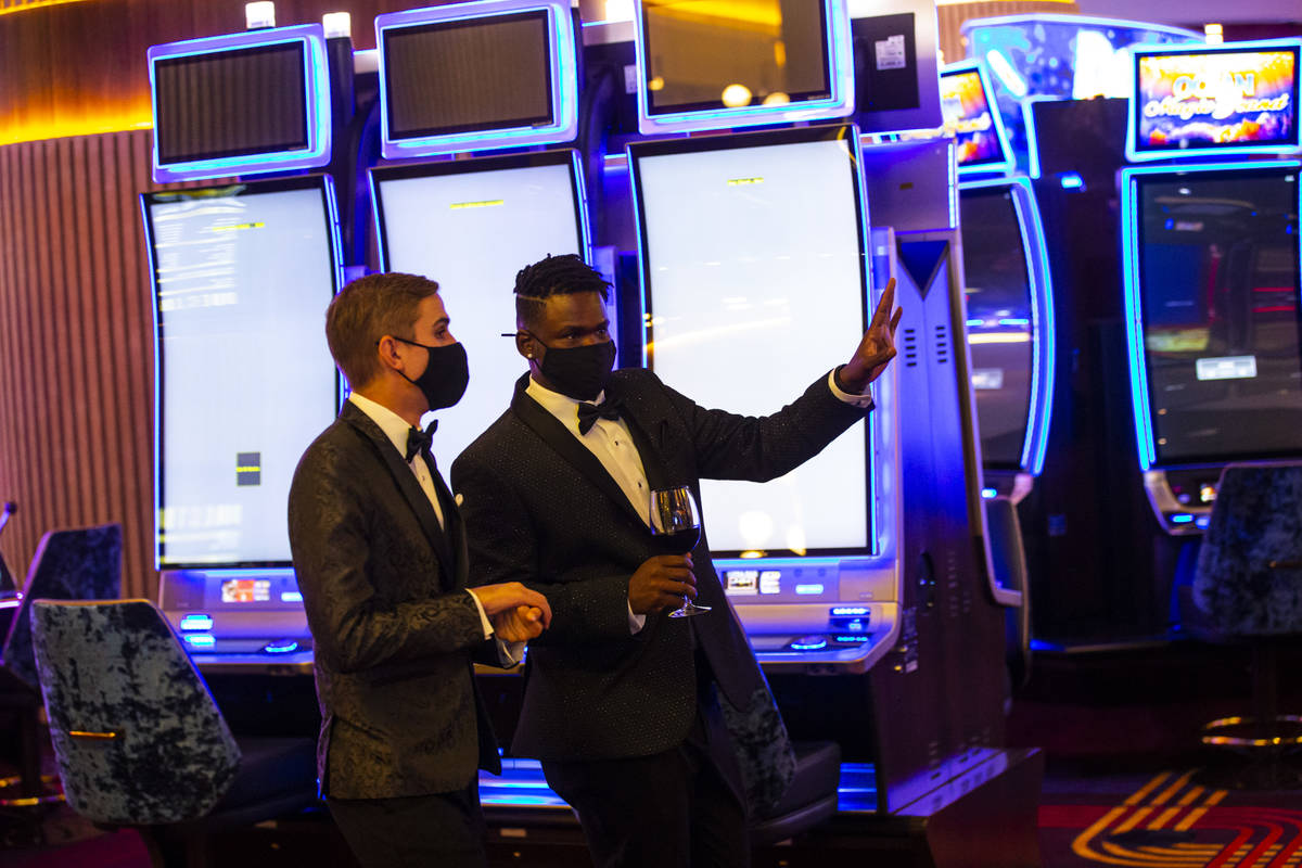 Invited guests explore Circa during the VIP black-tie grand opening event in downtown Las Vegas ...