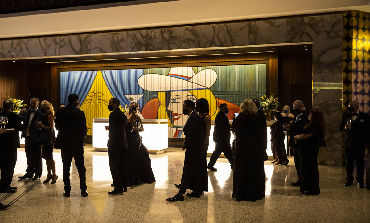 Invited guests line up to take a photo at the Circa lobby during the VIP black-tie grand openin ...