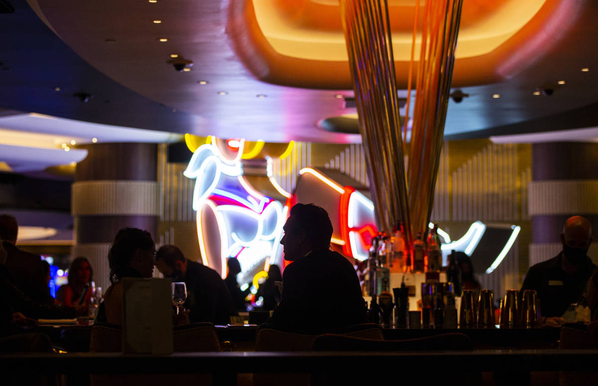 Invited guests relax at Vegas Vickie's at Circa during the VIP black-tie grand opening event in ...