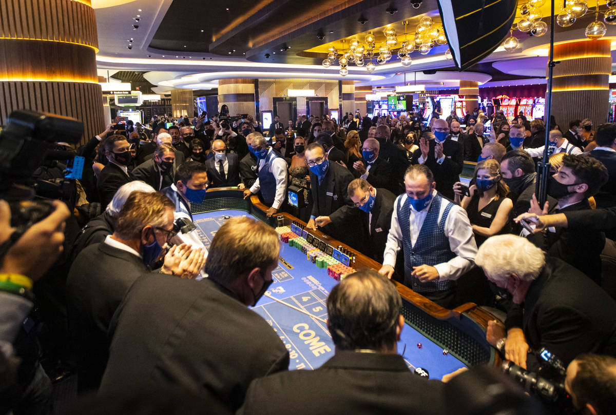 The first roll of the dice is thrown at a craps table at Circa during the VIP black-tie grand o ...