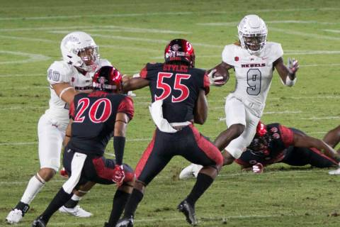 UNLV's Tyleek Collins runs the ball back on a kickoff return during Saturday's Mountain ...