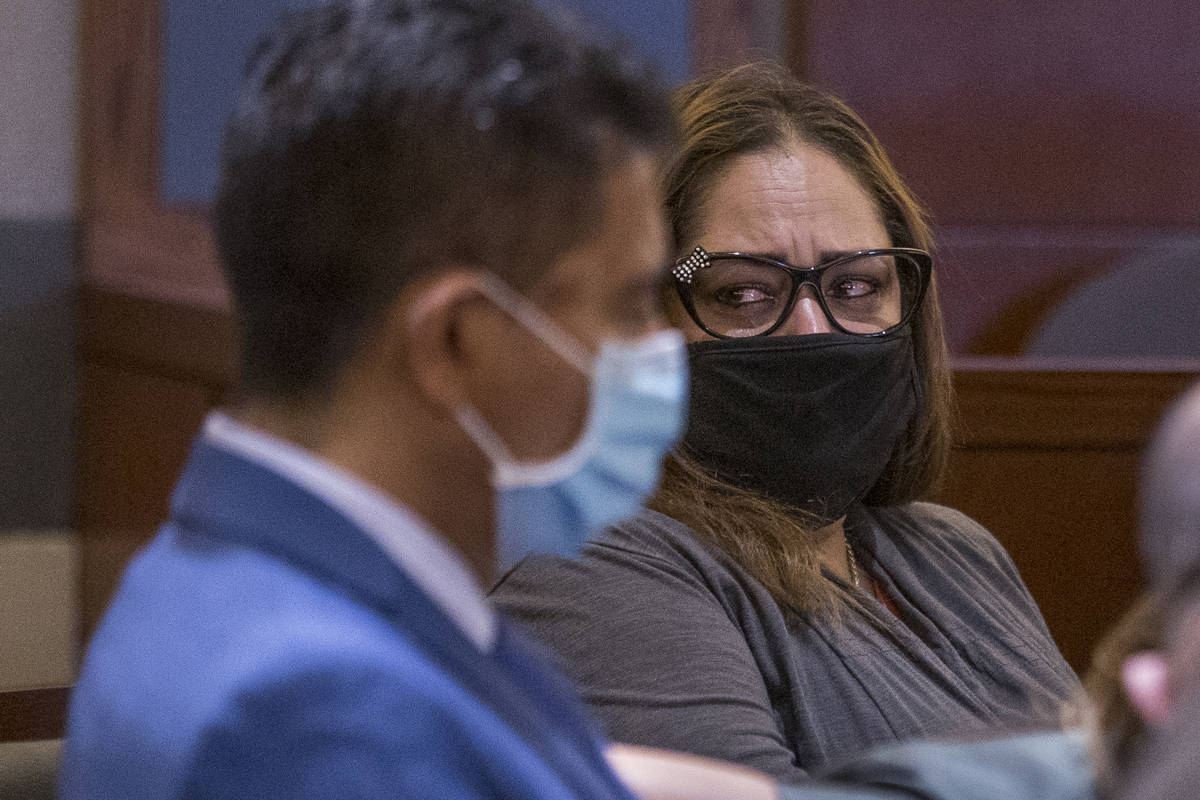 Defendant Malinda Mier, right, cries in court while viewing photos of victims during a prelimin ...