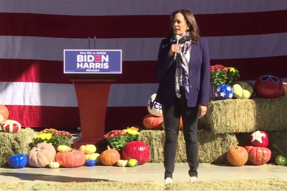 Democratic vice presidential candidate Sen. Kamala Harris, D-Calif., talks to supporters Tuesda ...