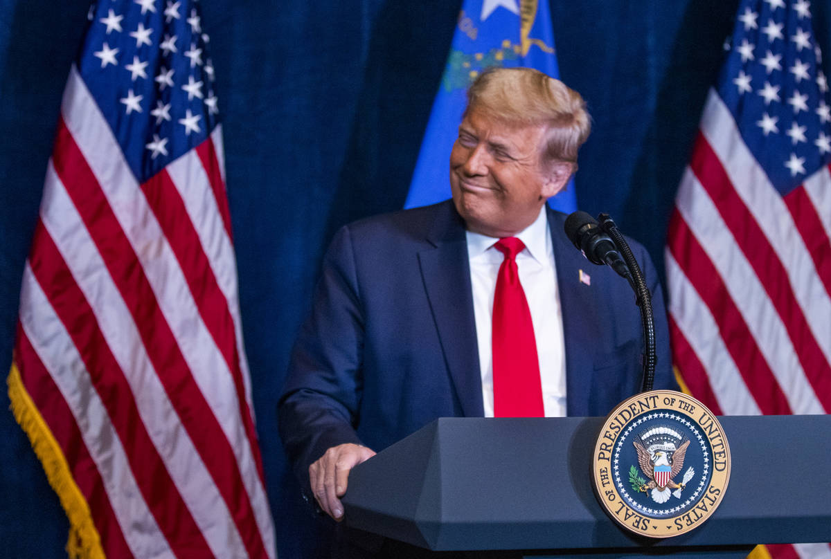 President Donald Trump listens to statements by Nevada business leaders large and small from th ...