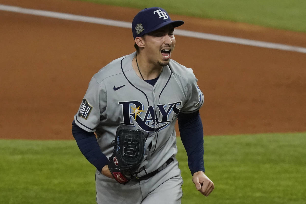 Tampa Bay Rays starting pitcher Blake Snell celebrates after striking out the side during the f ...