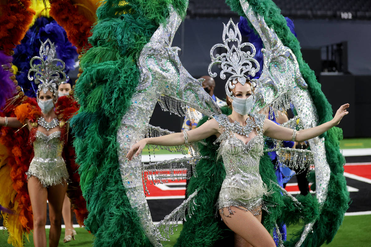 Las Vegas performers, including Elaine Hayhurst, right, put on a show at Allegiant Stadium as p ...