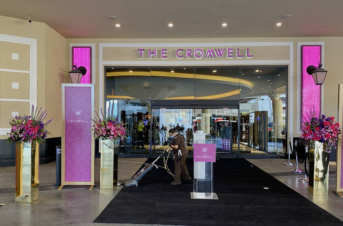 The carpet is vacuumed outside The Cromwell before a reopening ceremony on Thursday, Oct. 29, 2 ...