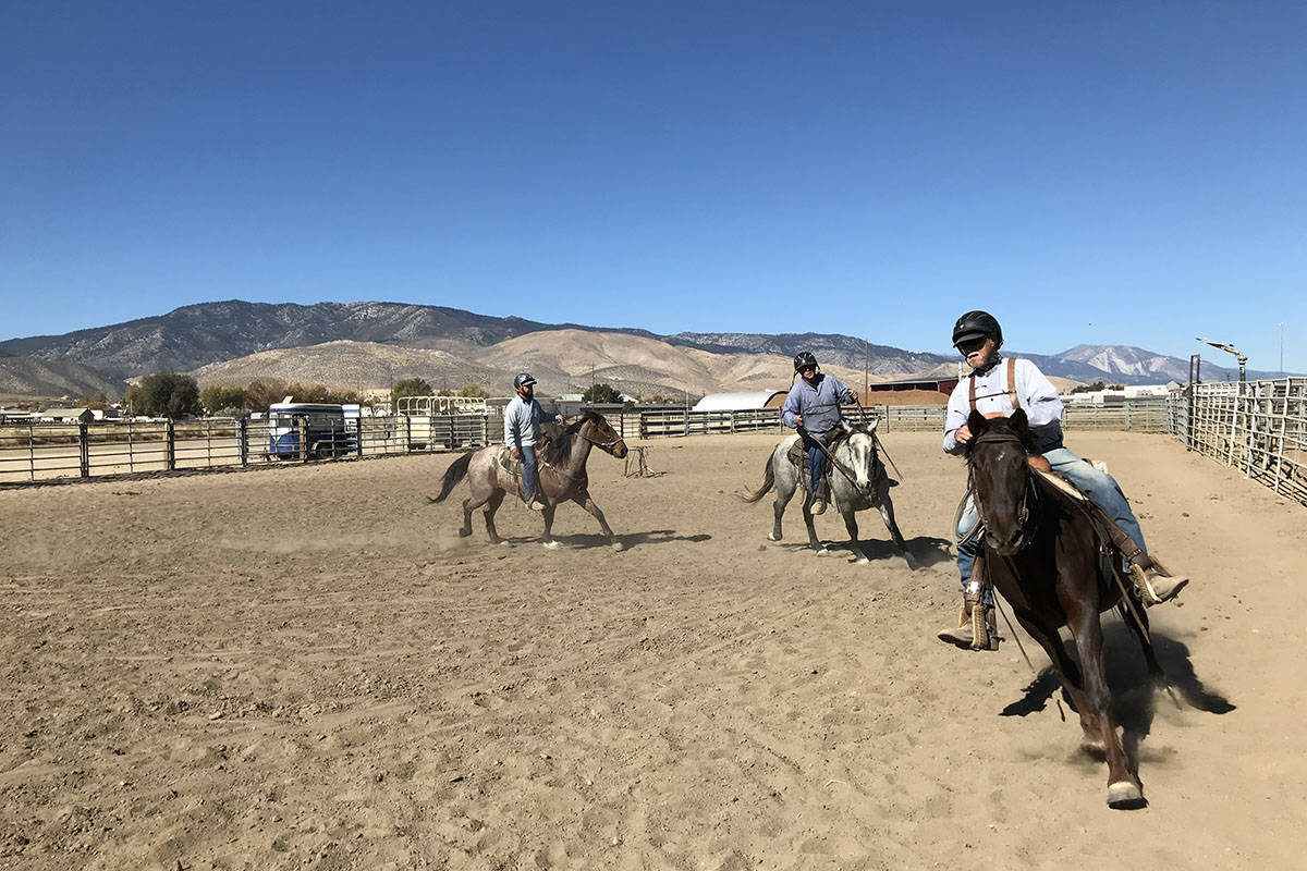 Inmates in the wild horse program at Stewart Conservation Camp work with their horses Tuesday, ...