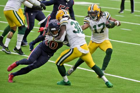 Green Bay Packers wide receiver Davante Adams (17) runs with the ball as Packers running back J ...