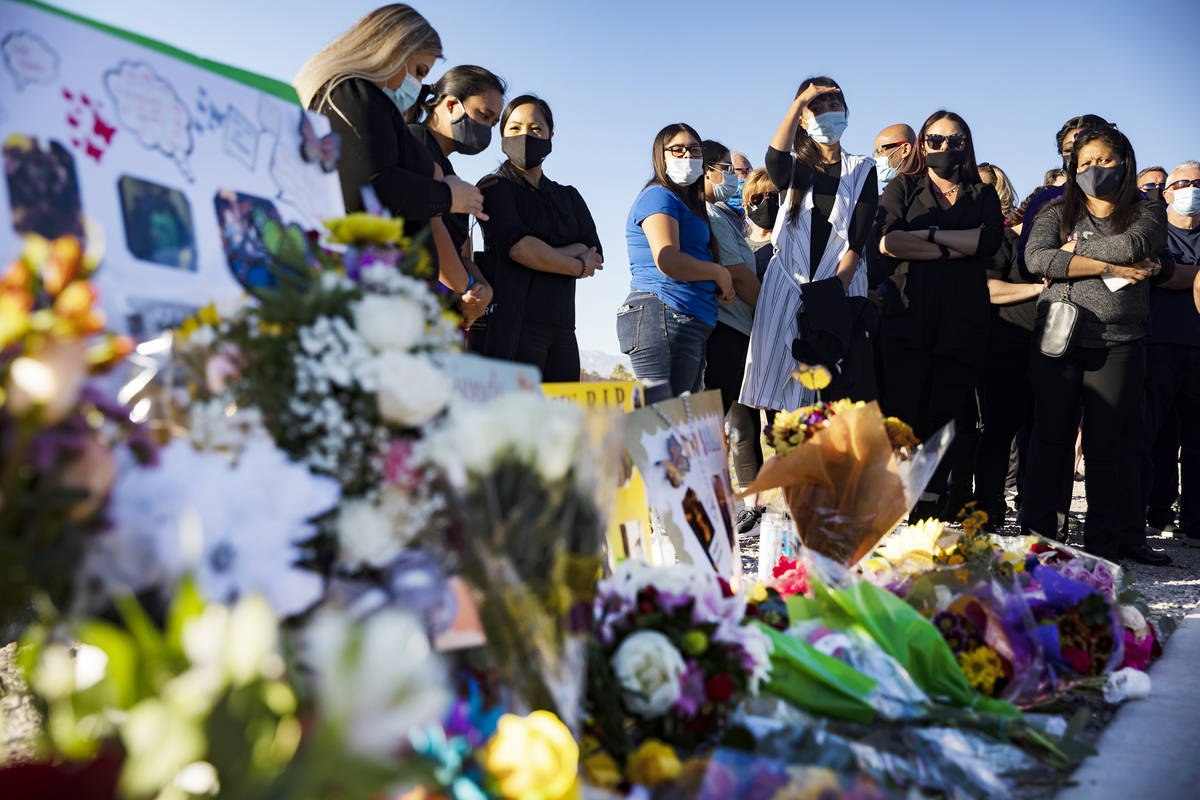 Mourners gather to pay their respects to Michelle Weissman, a bicyclist killed Sunday when a ma ...