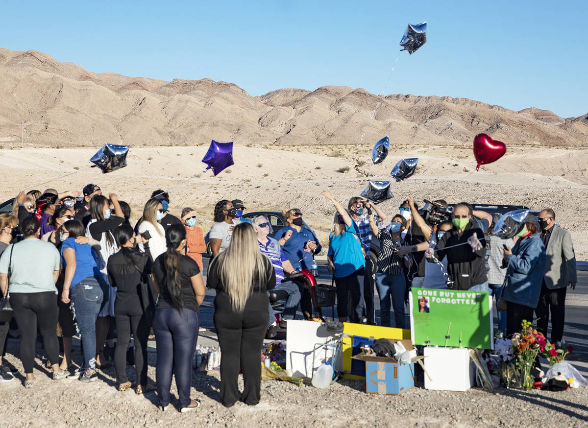 Mourners release balloons in honor Michelle Weissman, a bicyclist killed Sunday when a man lean ...