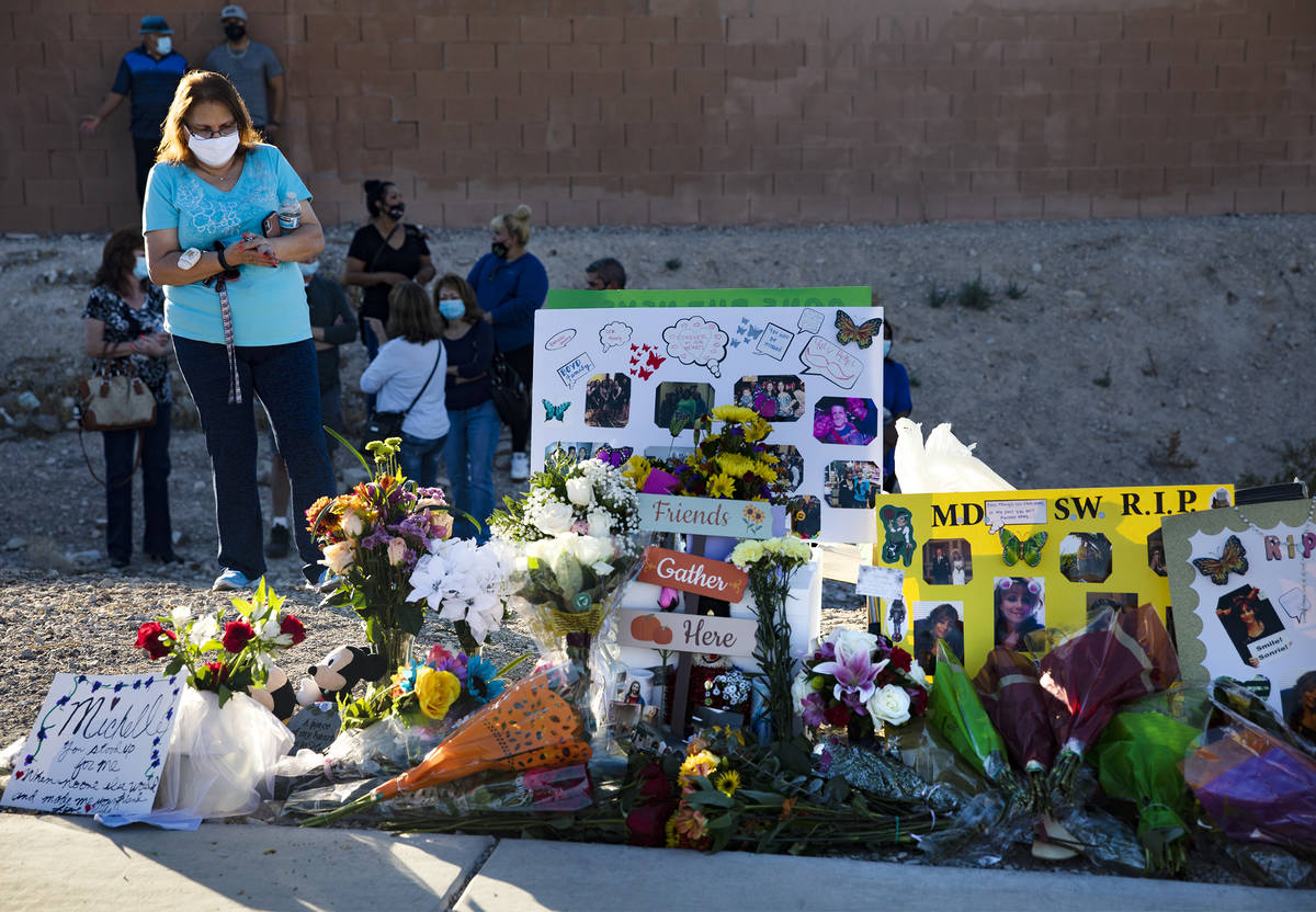 Flowers and photos at a makeshift memorial in honor of Michelle Weissman, a bicyclist killed Su ...
