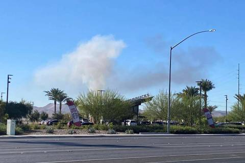 Smoke can be seen from Blue Diamond Road and Valley View Boulevard after the report of the cras ...