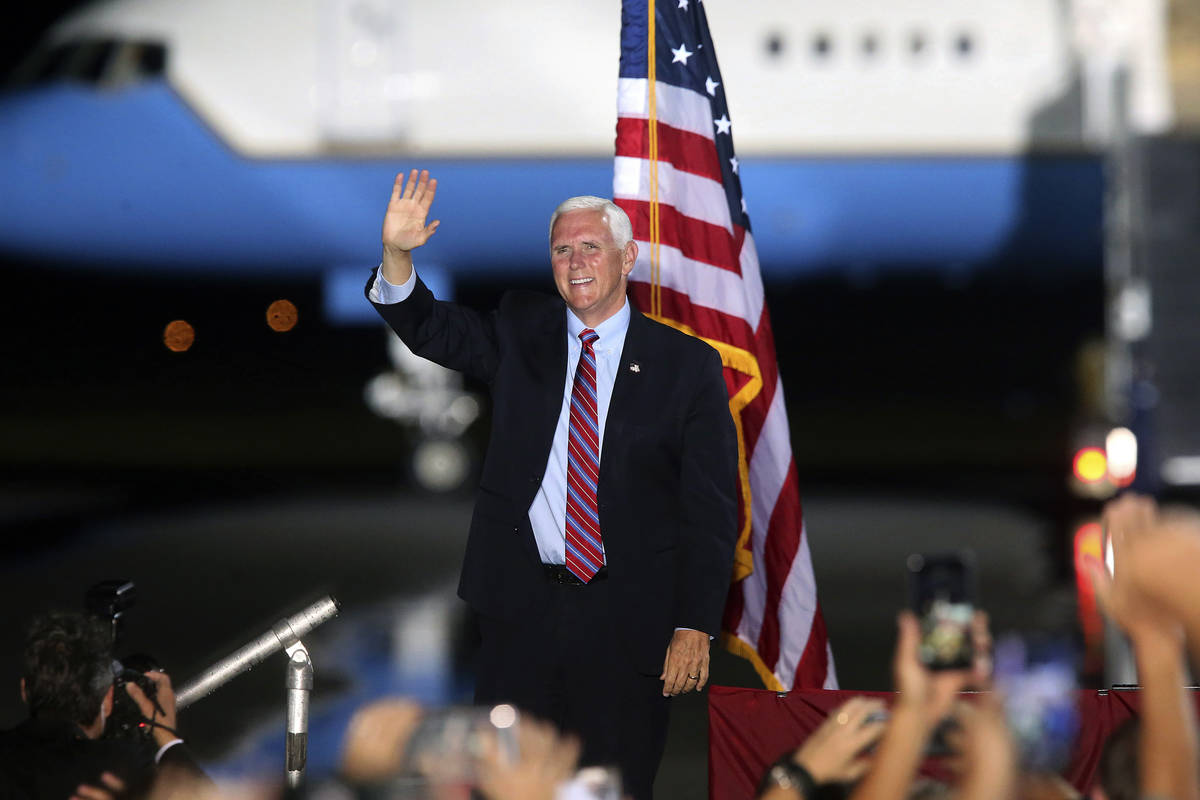 Vice President Mike Pence waves to supporters Saturday Oct. 24, 2020 in Tallahassee, Fla. Battl ...