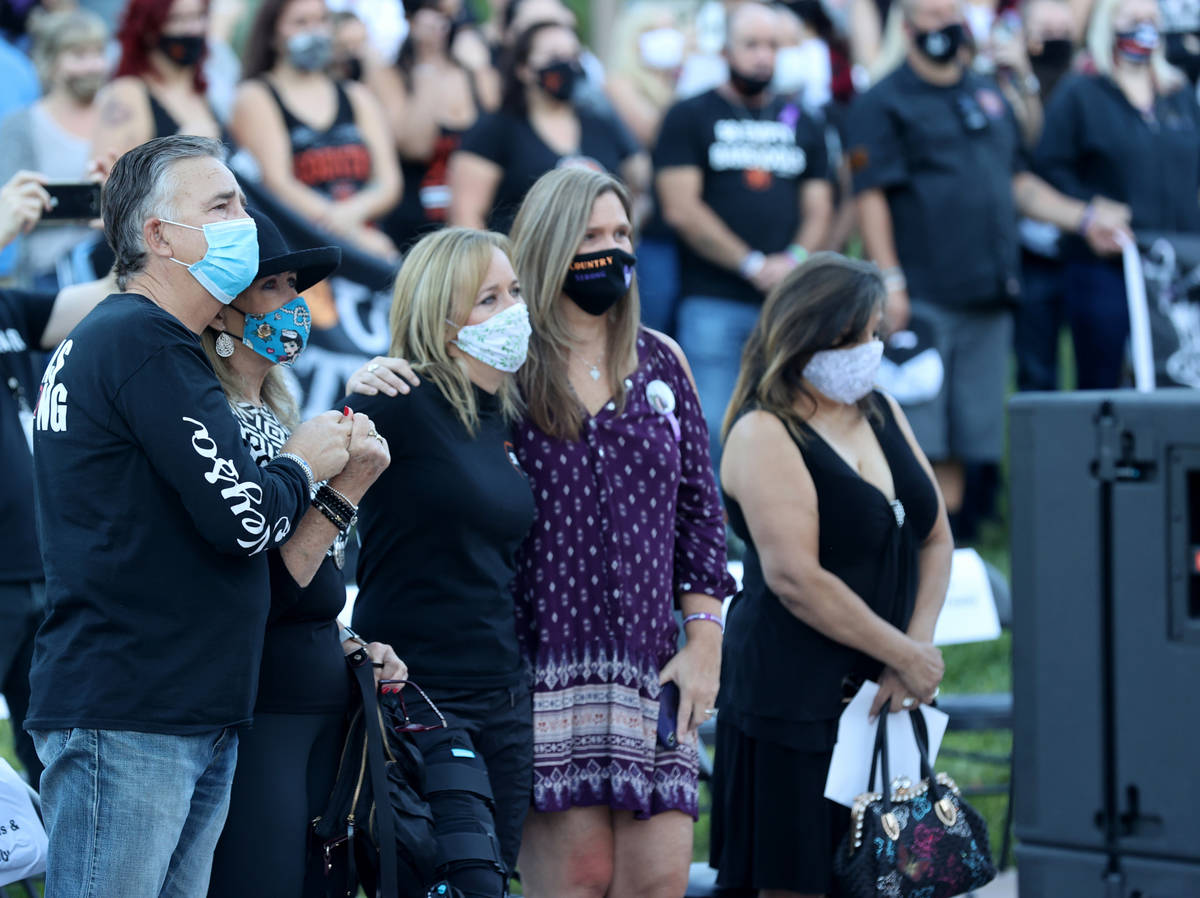 Chris Davis, right, of Las Vegas whose daughter Neysa Tonks was killed in the Route 91 Harvest ...
