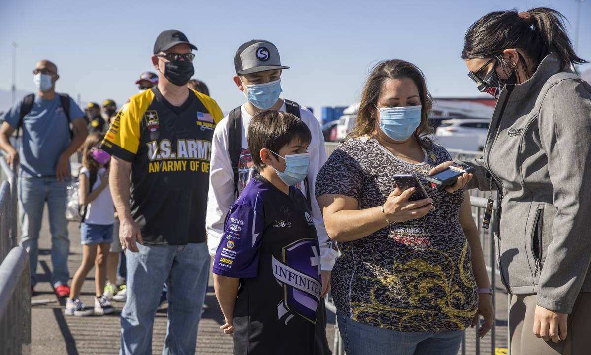 Fan Vanessa Roberts, center right, has her familyÕs tickets electronically verified by spe ...
