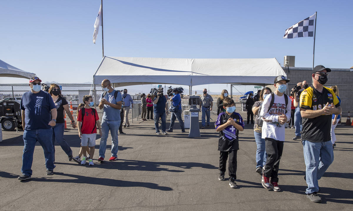 The Jaramillo, left, and Roberts, right, families enter the main gate as the Las Vegas Motor Sp ...