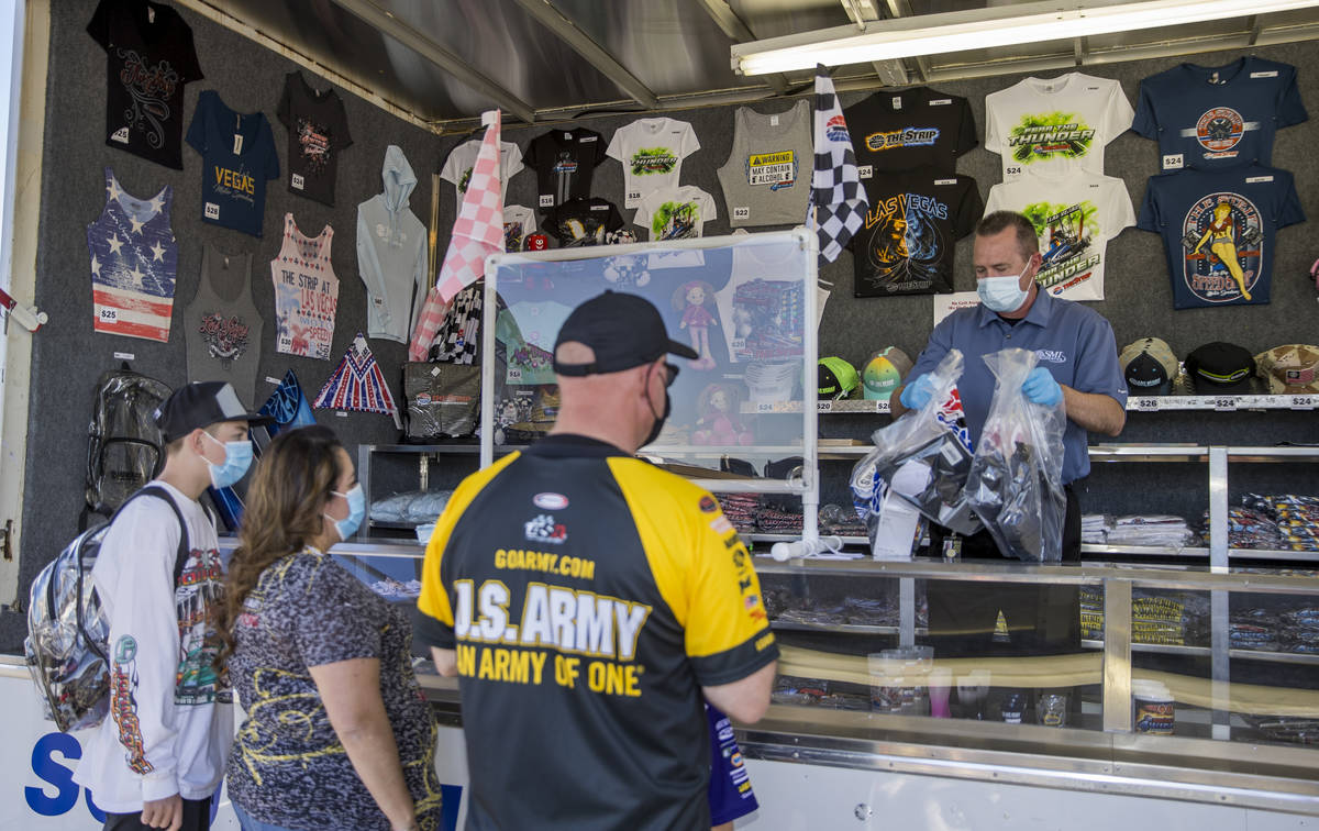 The Roberts family receive some souvenirs near the track as the Las Vegas Motor Speedway hosts ...