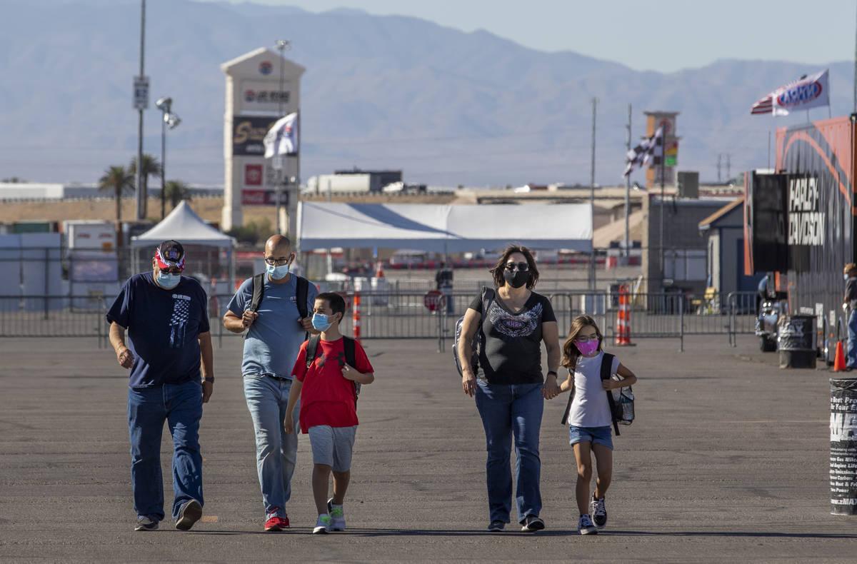 Race fans Santiago, Matthew, Aiden, 11, Rose and Quinn, 8, Jaramillo walk towards the track as ...