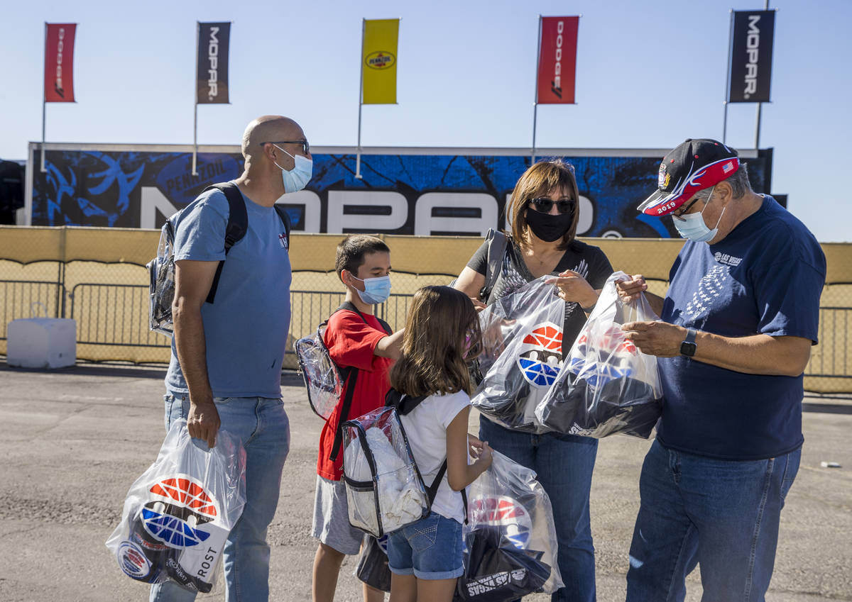 (From right) Race fans Santiago, Rose, Quinn, 8, Aiden, 11, and Matthew Jaramillo check out the ...