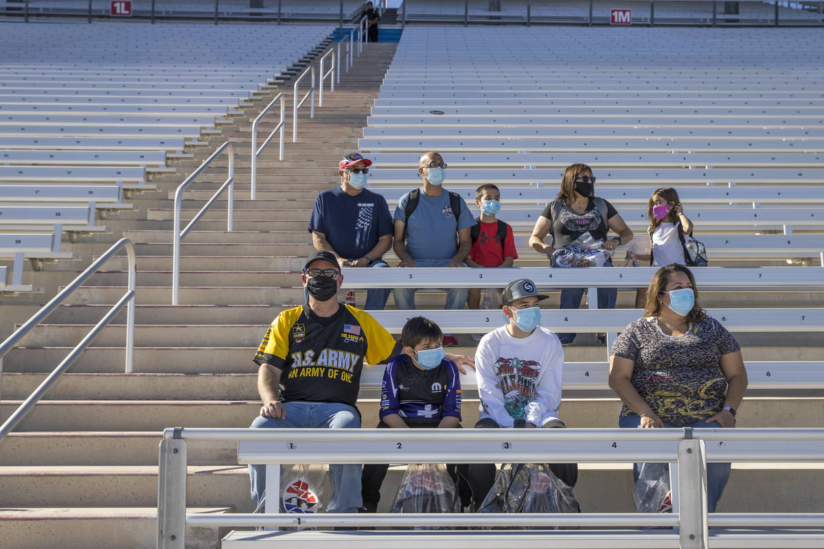 (From bottom) The Roberts and Jaramillo families sit in the stands about the track as the Las V ...