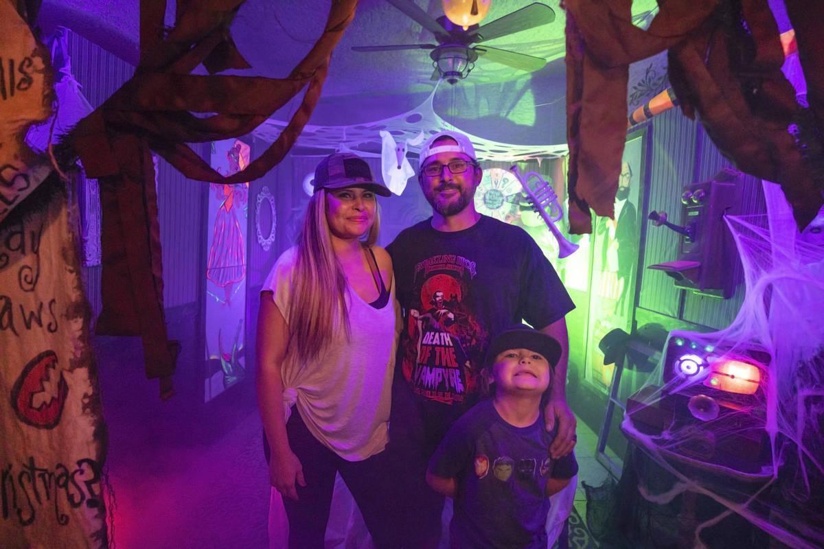 Tiffany Garcia, left, Leroy Garcia, center, and their son Logan, 6, is seen in their DIY Haunte ...