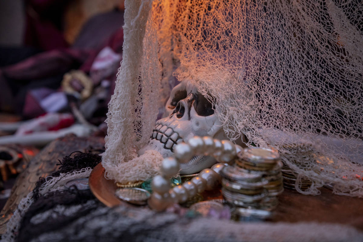 A skeleton scene from The Pirates of the Caribbean is seen in the Garcias' backyard for their D ...