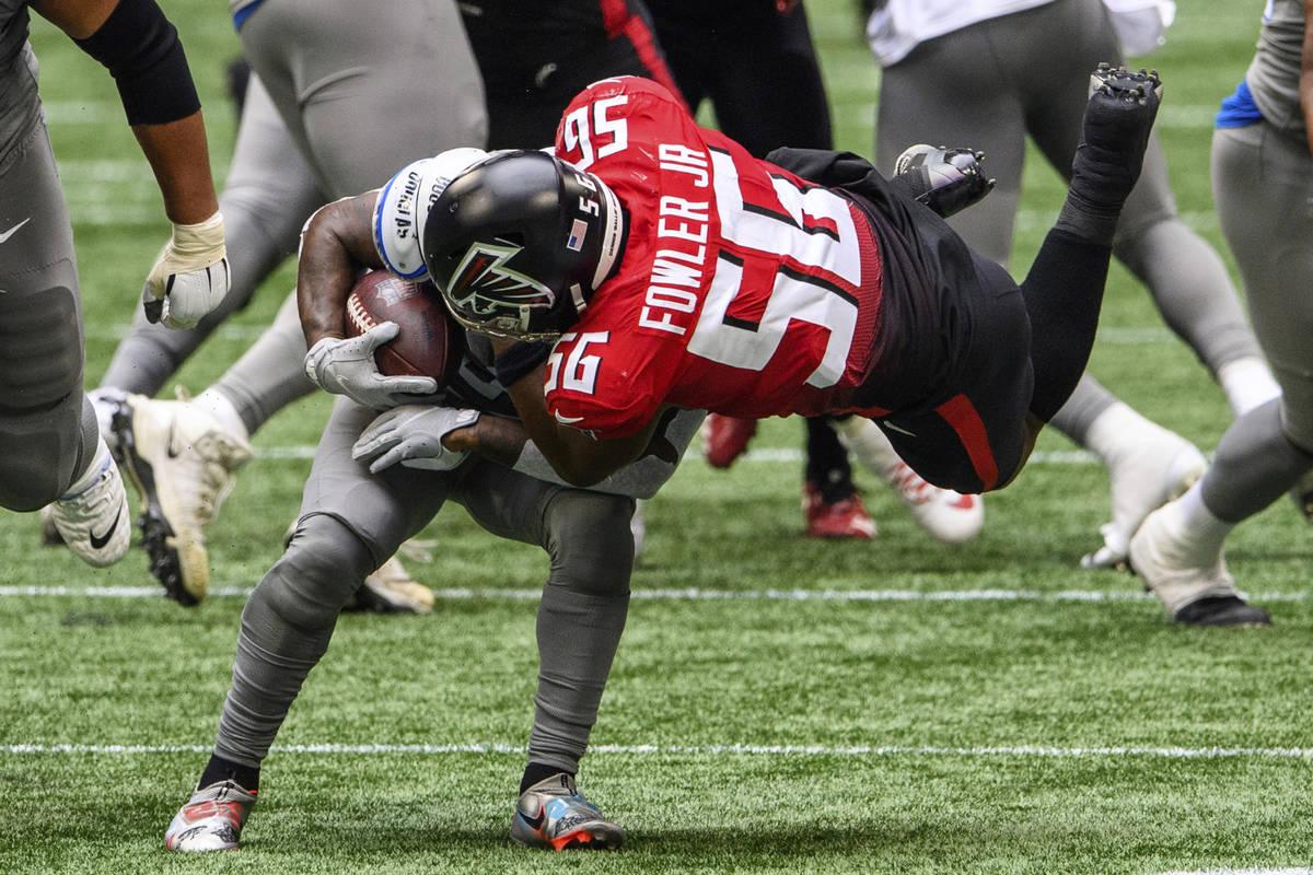 Atlanta Falcons defensive end Dante Fowler Jr. (56) tackles Detroit Lions running back D'Andre ...