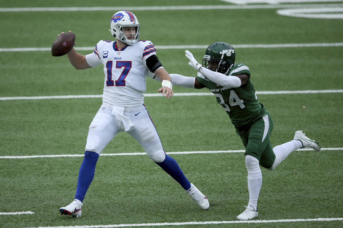 Buffalo Bills quarterback Josh Allen (17) in action against New York Jets cornerback Brian Pool ...
