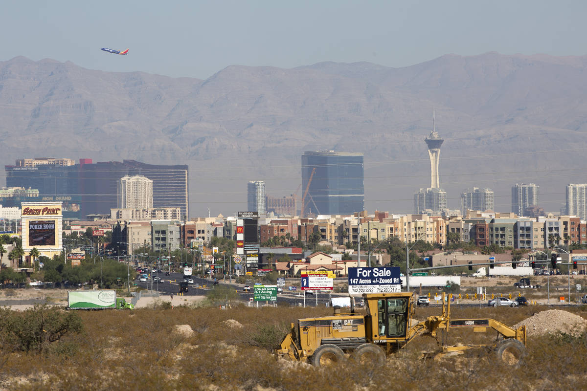 The Las Vegas Strip is in the background of the construction site of new apartment complex Ariv ...