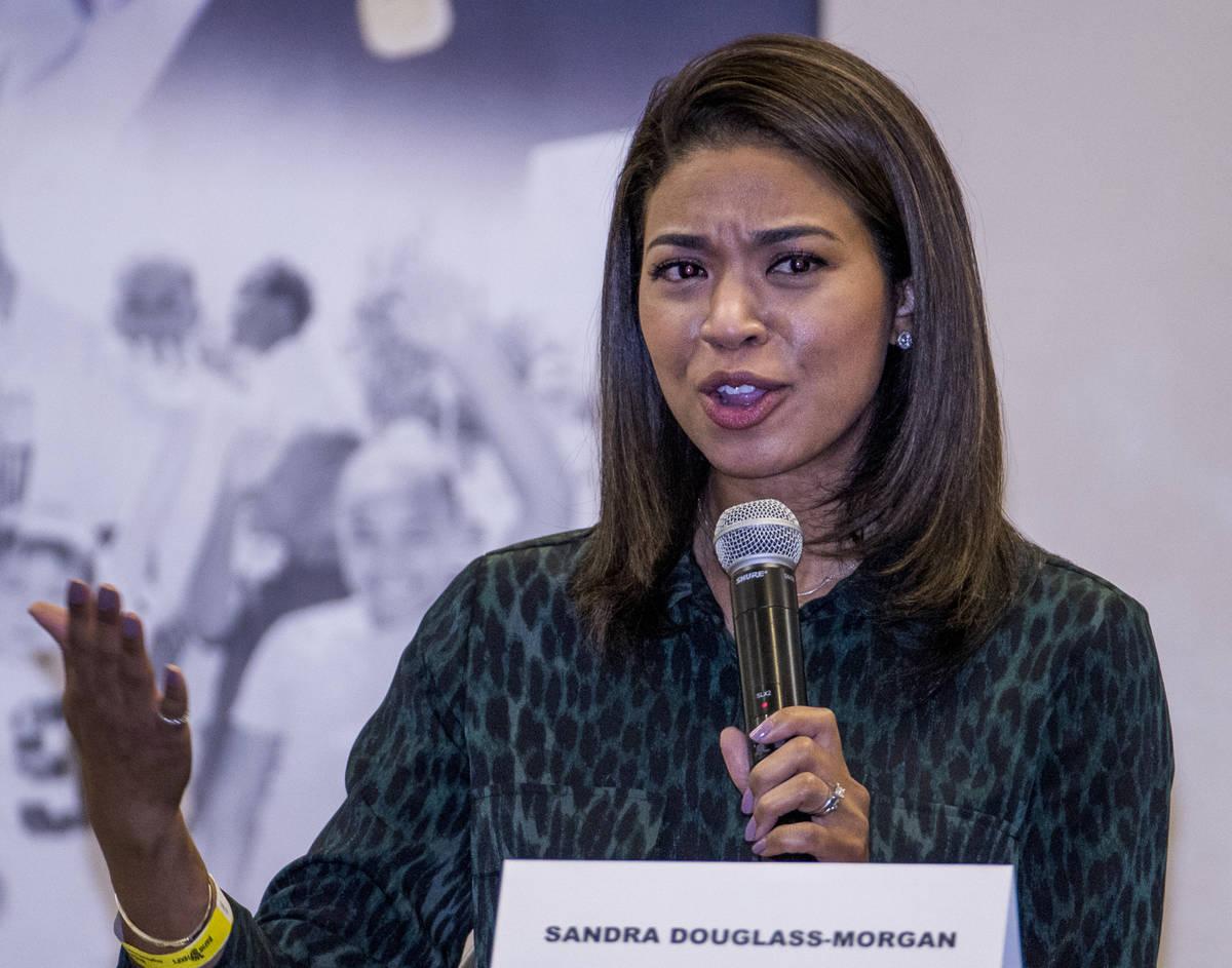 Panel member Sandra Douglass-Morgan speaks during a Solutions, Strategies & Service Summit rela ...