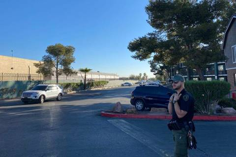 A security guard at an apartment complex on the 3700 block of University Center Drive where a d ...