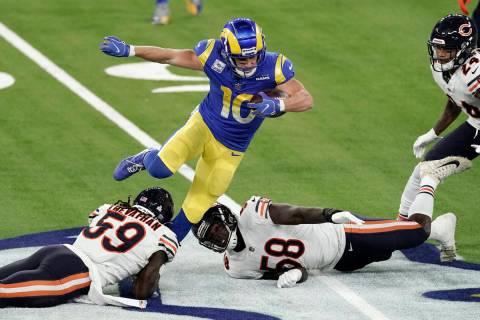 Los Angeles Rams wide receiver Cooper Kupp, top, leaps over Chicago Bears inside linebacker Dan ...
