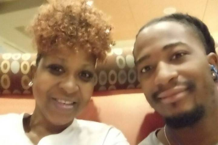 Belinda Jackson is seen with son DeAndre Harris, who was shot to death in October 2020 in North ...