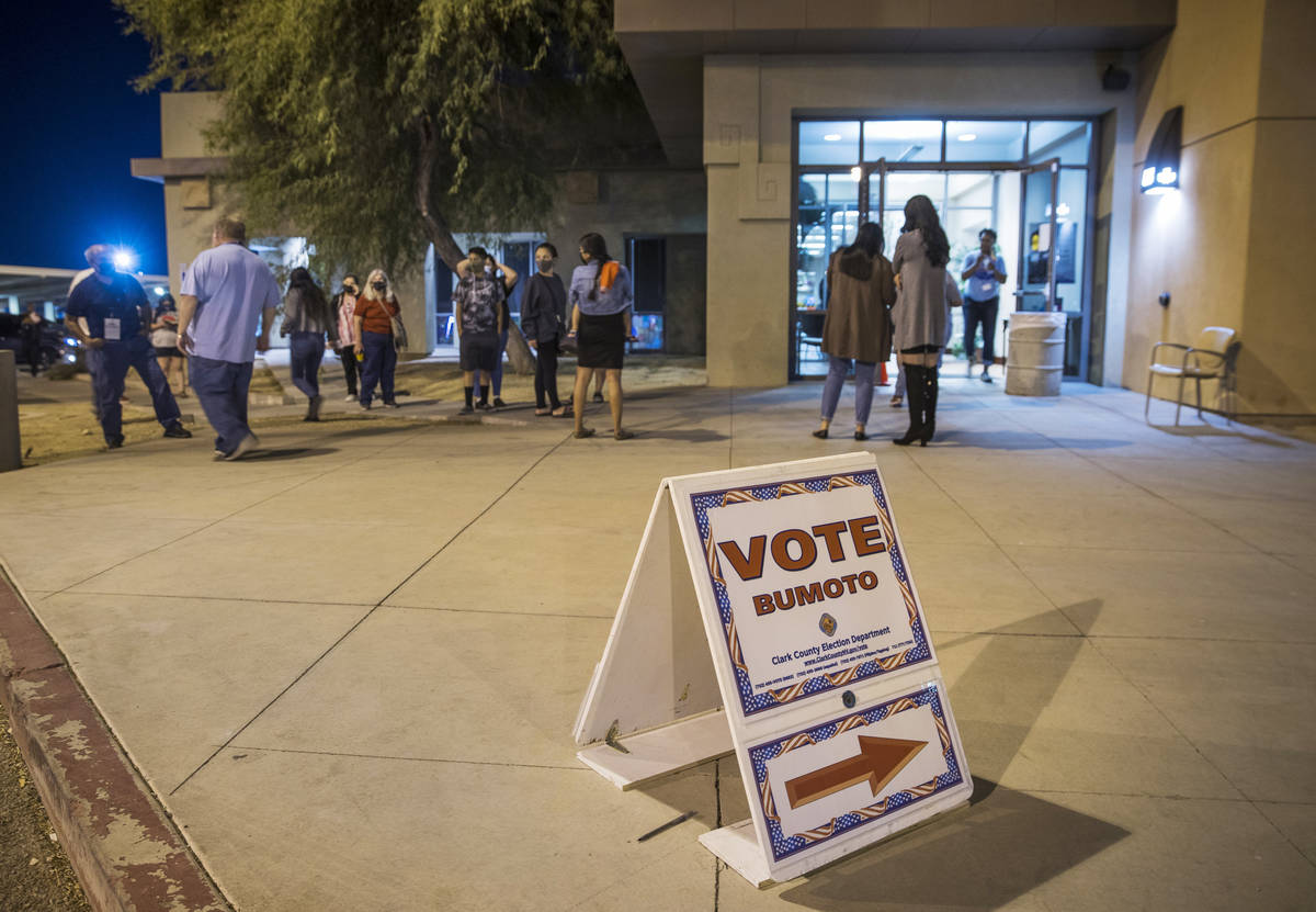 A line wraps around the entrance during the last night of early voting at the East Las Vegas Co ...