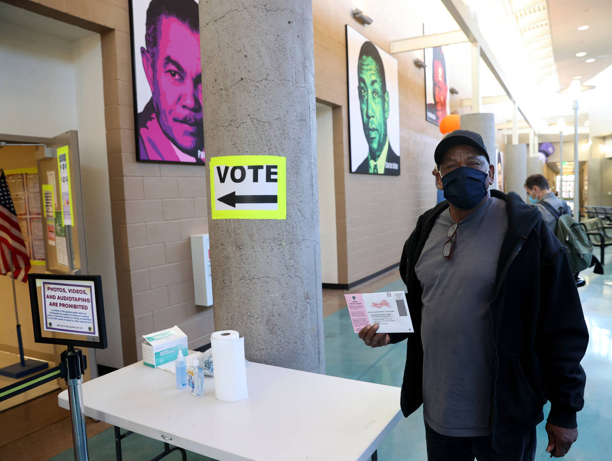 Donald Prentiss, 60, of Las Vegas prepares to drop off his ballot on the last day of early voti ...