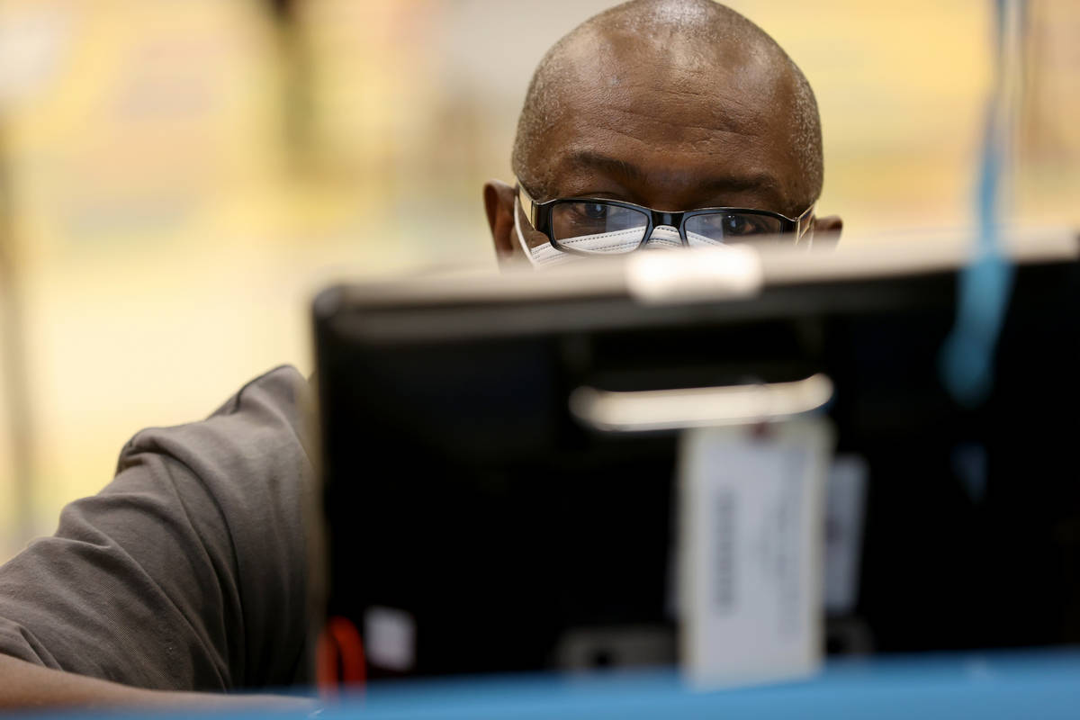 Mike Williams, 57, of Las Vegas, votes on the last day of early voting at Pearson Community Cen ...