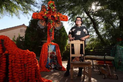 Isaias Urrabazo, poses for a portrait next to an altar he created at his home in Las Vegas, Wed ...