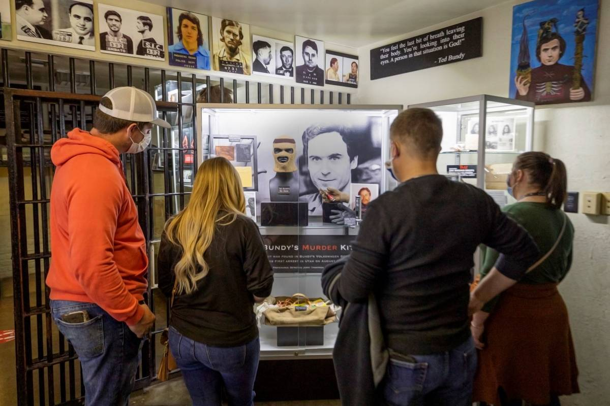 Tourists from Jackson, Georgia, look at belongings from Ted Bundy during a tour of Zak Bagans' ...