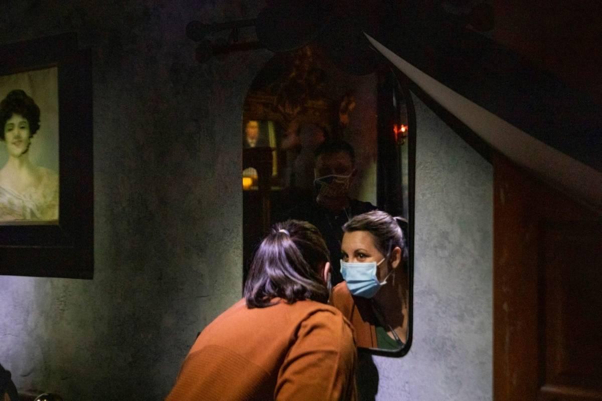 Deanna James, 46, and Jerry James, 50, of Jackson, Georgia, look into Bela Lugosi's haunted mir ...