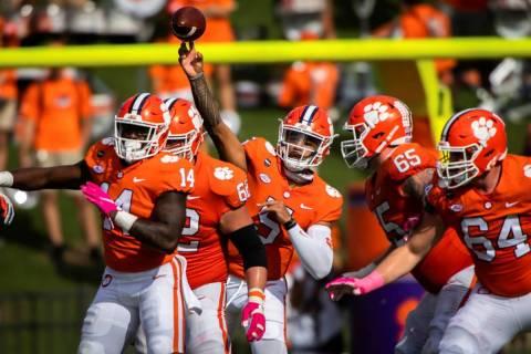 Clemson quarterback D.J. Uiagalelei (5) makes a pass during an NCAA college football game again ...