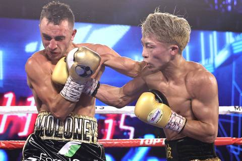 Naoya Inoue, right, connects with a punch against Jason Moloney during their bantamweight title ...